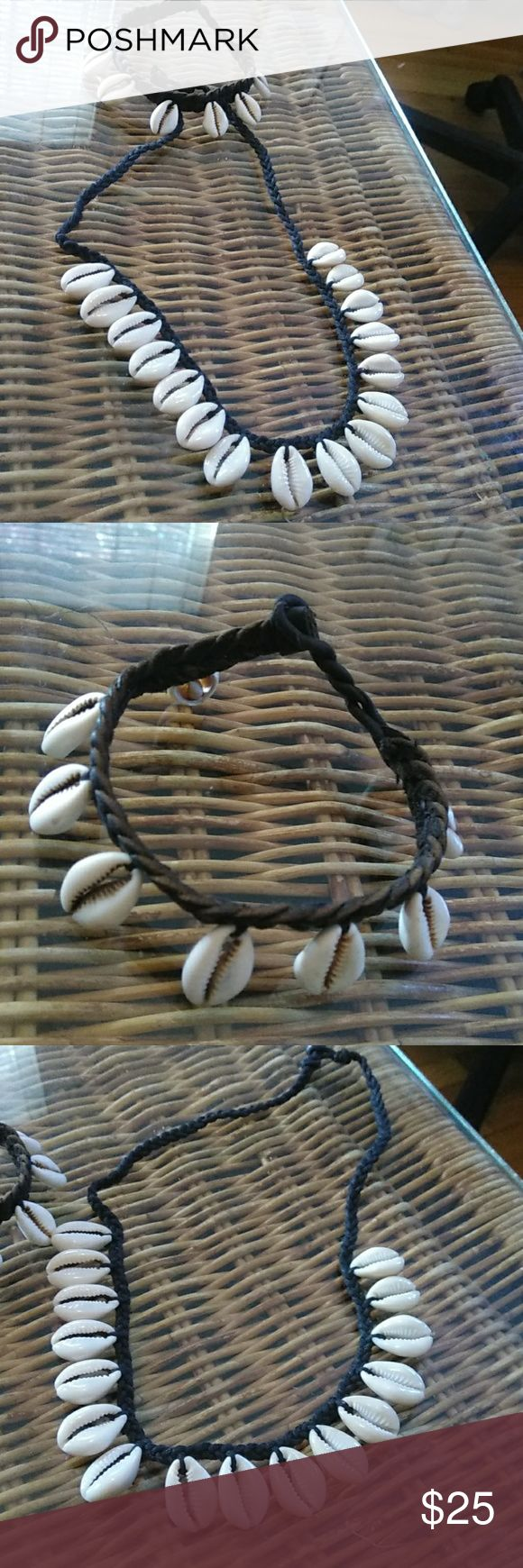 This is a Conch shell necklace and bracelet set Braided brown leather straps with conch shells attached can be worn by male or female. Jewelry Necklaces