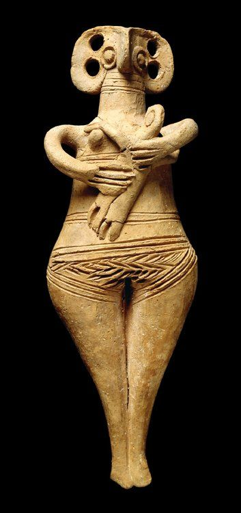 Terracotta figure holding an infant 1450-1200 BC Late Cypriot II Culture