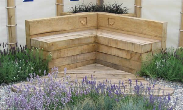 Bench made of stagged up timber sleepers unusual garden for Sleeper garden bed designs