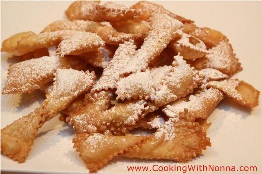 Chiacchiere Baresi > 1 Lb Flour, 6 Oz White wine, 4 Oz Olive oil, 1/4 Lb Sugar, Powdered sugar, Olive oil for frying