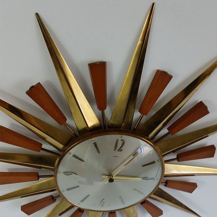 Retro sunburst wall clock by Metamec. A real classic. Keeps perfect time and uses a standard AA battery. Made in England.