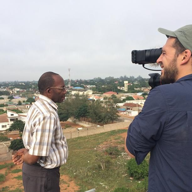 Water Facility SME owner, Unacio Macambo, looks out from atop his water tower in Albasine, Maputo (1)