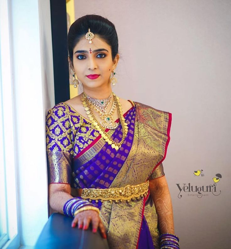 South Indian bride. Gold Indian bridal jewelry.Temple jewelry. Jhumkis.Purple silk kanchipuram sari.Braid with fresh jasmine flowers. Tamil bride. Telugu bride. Kannada bride. Hindu bride. Malayalee bride.Kerala bride.South Indian wedding.