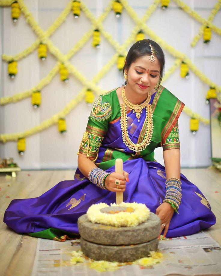 South Indian bride. Gold Indian bridal jewelry.Temple jewelry. Jhumkis.Purple and green silk kanchipuram sari.braid with fresh jasmine flowers. Tamil bride. Telugu bride. Kannada bride. Hindu bride. Malayalee bride.Kerala bride.South Indian wedding.