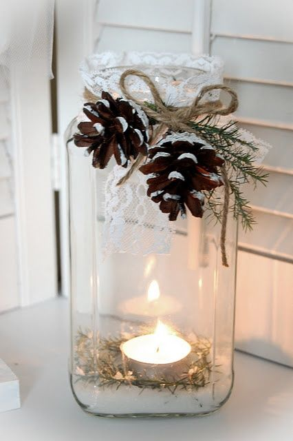 mason jar with candle inside.  greenery, pinecones and twine tied on.  Great down banquet tables with a burlap runner at christmas time