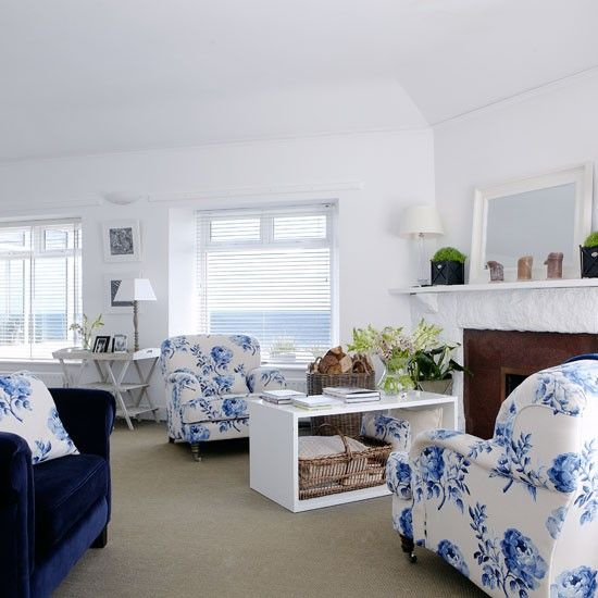 For a calmer, more elegant take on the theme choose a #bold #floral print in keeping with the classic #coastal colours blue and white. White walls and furnishings as well as rustic textures also work to give a coastal vibe.