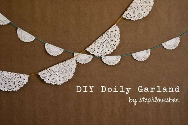 Doily Garland ~ very cute idea!  You could even spray paint the doilies to match your wedding (or party) colors.
