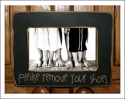 "I would probably say something like this as it's less offensive & would provide a basket full of socks & slippers for those uncomfortable with taking their shoes off & another basket for me to wash them once they've been used. ""Welcome friends…please have a seat…we love to pamper our guests and their feet."""