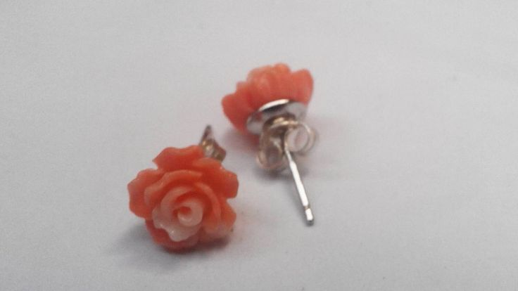 A personal favourite from my Etsy shop https://www.etsy.com/listing/267642131/silver-studs-coral-rose-earrings-stud