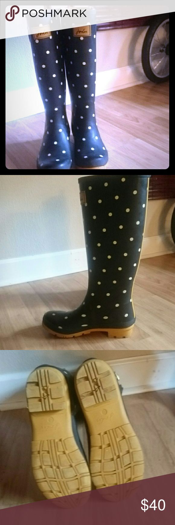 Joules size 8 wellies/ rain boots Brand new worn once Joules rain boots. They are black and gold with white polka dots. Very cute but were too big for me. Joules  Shoes Winter & Rain Boots