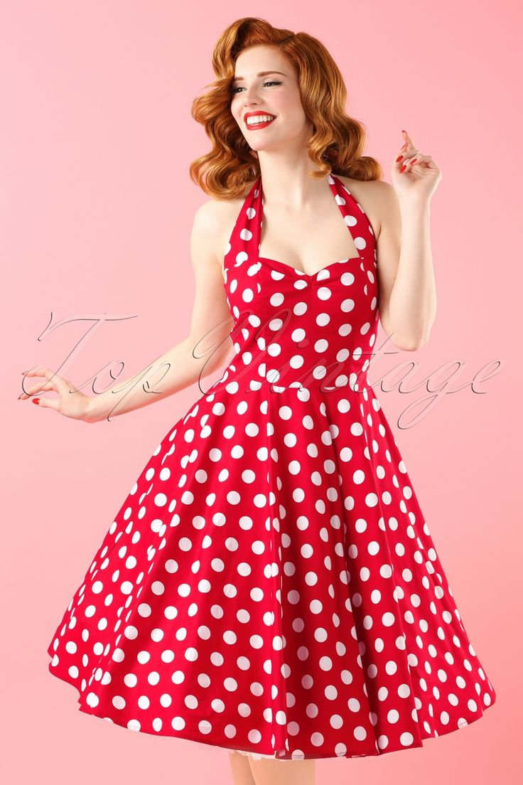 Gorgous 1950s style halter Meriam Swing Dress in Polka red white from Bunny. This is an iconic vintage style halterneck dress, in a playful polka dot print ending in a flowing full circle skirt made of coton with stretch. The back has an elasticated panel which ensures a tight fit around the bust and waist, the top is lined with the same fabric. This 50s vintage style dress can also be worn with a petticoat underneath to add volume. Hits below the knee with a height of 1....