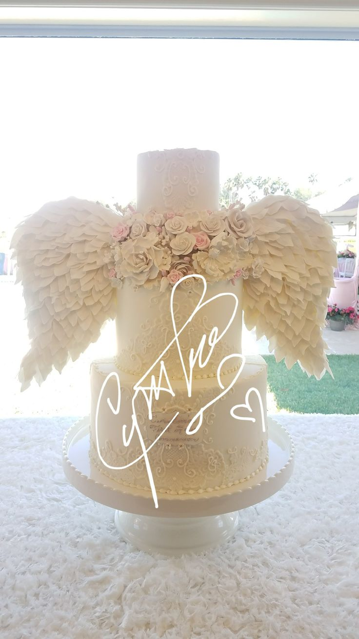 Angel wings communion cake is heavenly! #angelwingcakes #extravagantcakes #angel Created by www.cynthiascakesllc.com