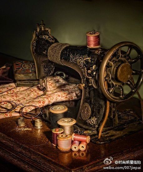 Antique Sewing Machine as base for displaying linens