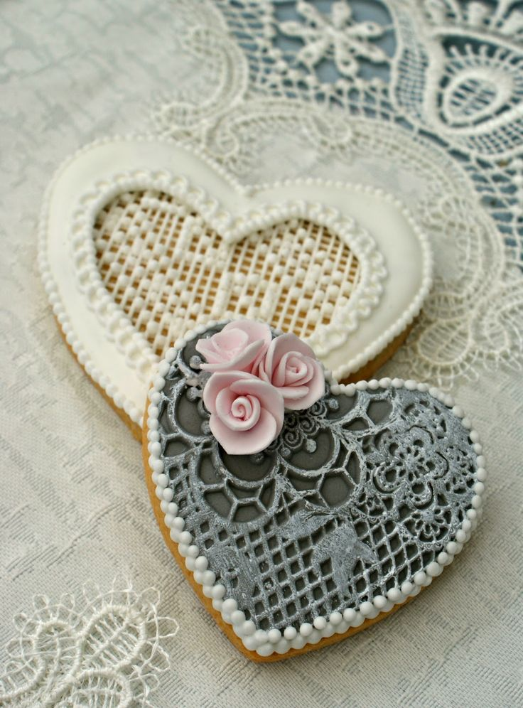 Shabby chic cookies... I'd stay away from the plain white since there's no wedding gown but that blue one with the pink roses... god, it's lovely.