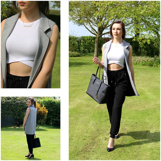 Get this look: http://lb.nu/look/7416414 More looks by Claudia St Quintin: http://lb.nu/claudiastq Items in this look: New Look Wrap Front Crop Top, Michael Kors Black Tote, New Look Smart Crepe Joggers, Office Patent Heels, Topshop Sleeveless Jacket, H&M Bar Necklace #simple #minimal #ootd #chic #smart #blogger #fblogger