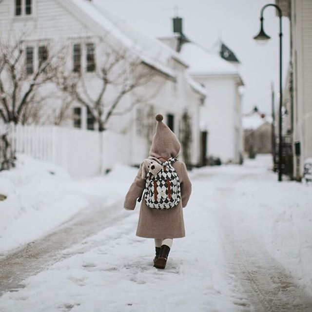 "#tbt to last winter (I'm so longing for snow these days) when little e went exploring with ""Liv"" in her backpack."