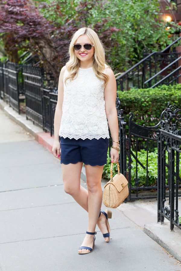 preppy summer outfit: lace top, scalloped shorts, wicker handbag, simple ankle strap sandals