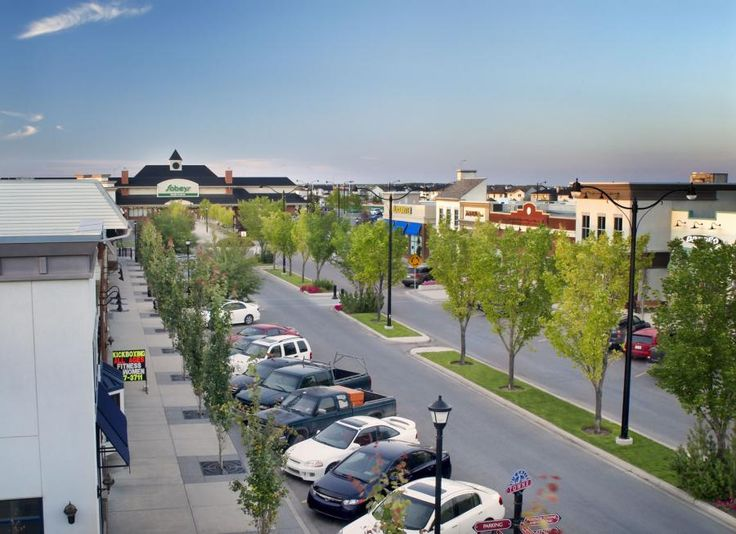High Street - Small shops complemented with larger one create a vibrant, urban gathering space. www.livemckenzietowne.ca
