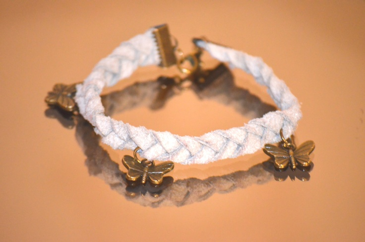 A leather bracelet with three little butterflies - powerful Feng Shui symbol!