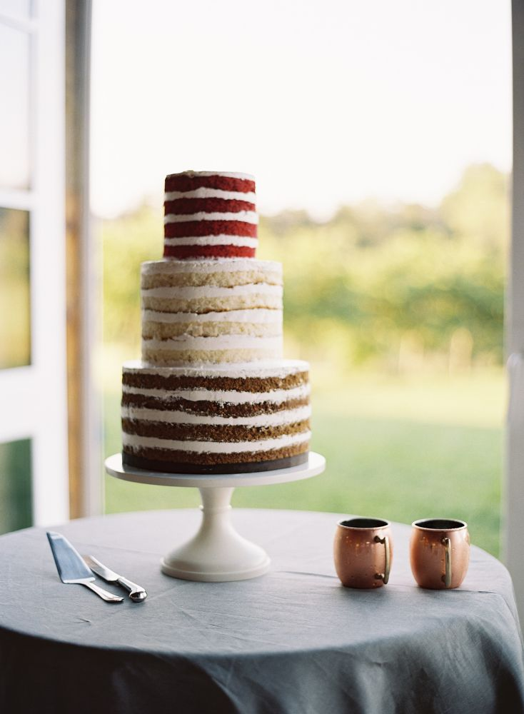 Naked cake with chocolate, vanilla, and red velvet layers | Photo by Eric Kelley