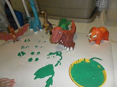 D for dinosaurs, footprint painting with toy dinos