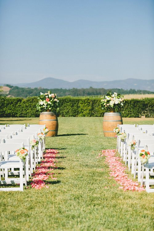 An outdoor vineyard wedding ceremony | @onelovephoto | Brides.com