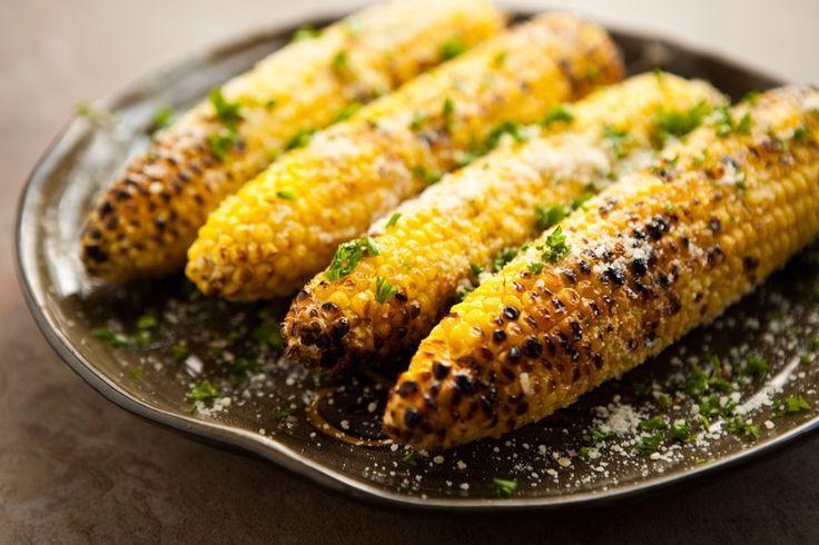 Parmesan Garlic Grilled Corn #recipe - 4 ears of fresh corn /  2 tablespoons butter /  1 clove garlic, grated /  1/4 cup freshly grated Parmesan cheese /  1 tablespoon freshly chopped Italian parsley, for garnish