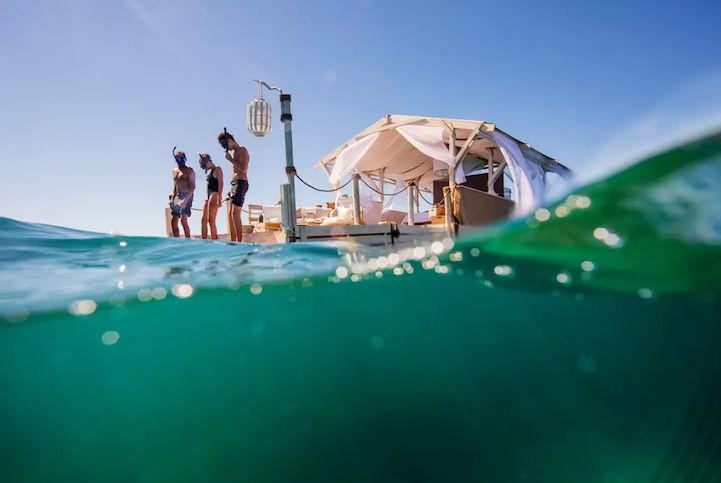 Airbnb is back at it again with another amazing rental opportunity. Within the last six months, they've made it possible to sleep among sharks and live in a famous Van Gogh painting. Now, they're taking fun in the sun to a whole new level with a gorgeous floating home on Australia's Great Barrier Reef.