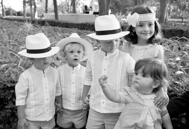 Ring boys with mini guayaberas and Panama hats (wedding in Spain)