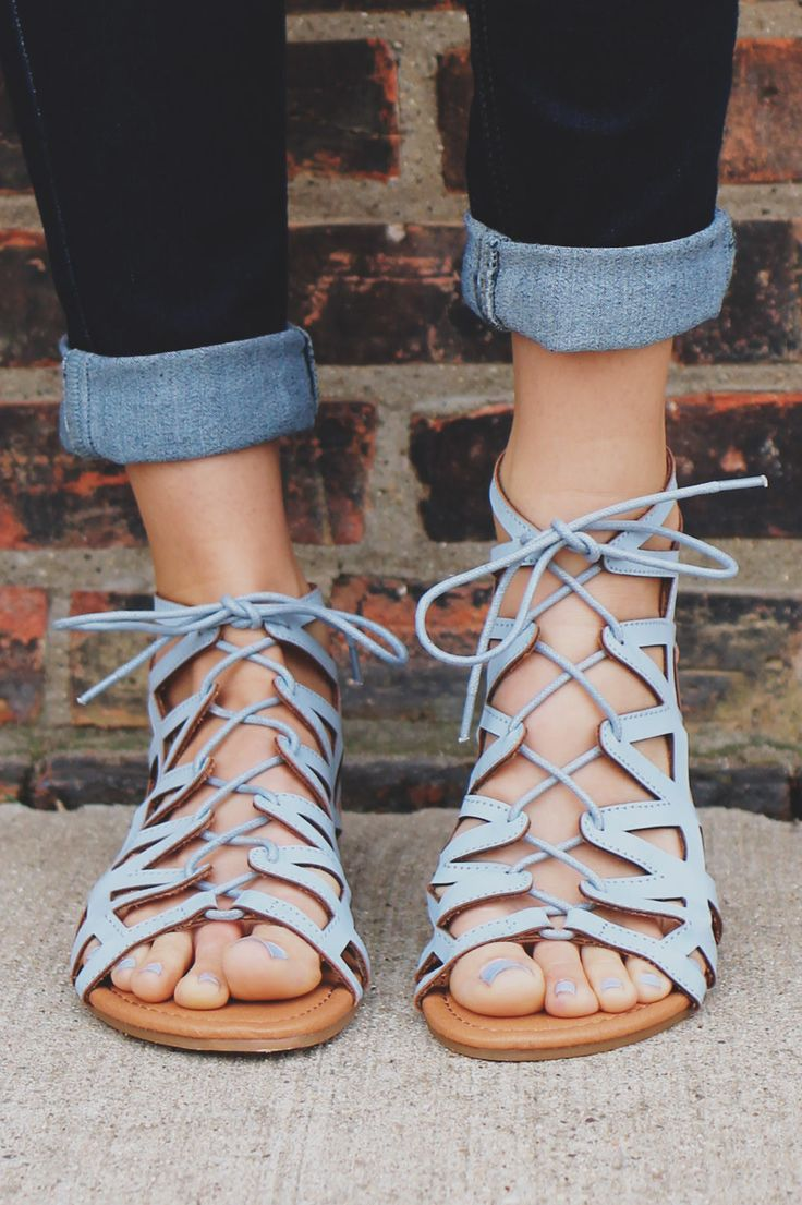 We are obsessed with baby blue this season and our Crossroads Sandals are no exception! They are a pair of faux leather, cutout, gladiator style flat sandals featuring a lace up front, zipper back and