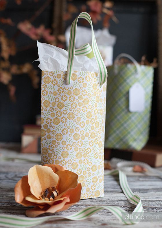 gift bag from scrapbook paper.  --- This came out pretty cute and I used Washi Tape on the seams. Two pieces together makes a larger bag!