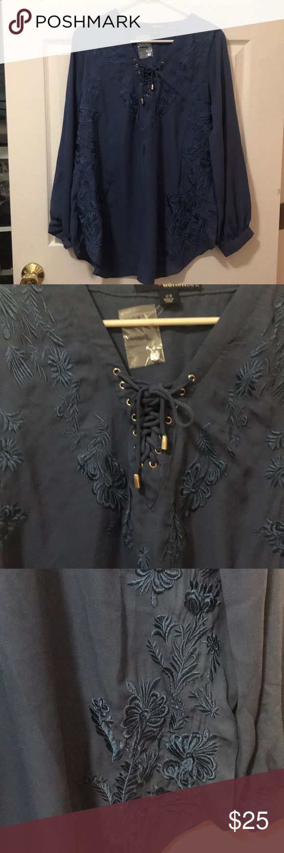 Brand new with tags DENIM 24/7 blouse!! Beautiful blue dress blouse!! Never worn!! From Denim 24/7!! Beautiful appliqué on front and back!! Can be worn with jeans or leggings! Or dress pants for work! Denim 24/7 Tops