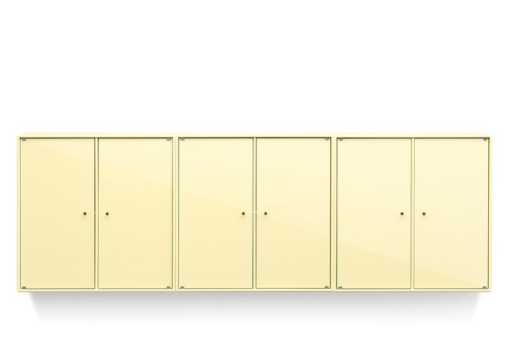 SHINE is a classic wall-mounted cabinet with elegant lacquered glass doors. This one in Lemon Drop is ready for Easter to come. #montanafurniture #easter #shine #danish #design #yellow #diningroom #livingroom #yellow #cabinet