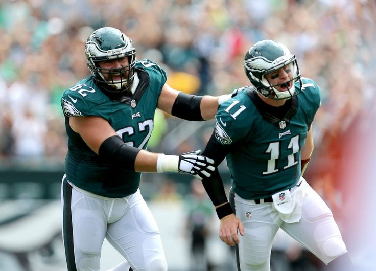 Eagles QB Carson Wentz (11) celebrates his touchdown pass with C Jason Kelce (62) in the first quarter vs. the Cleveland Browns at Lincoln Financial Field in Philadelphia, Sunday, Sept. 11, 2016. It was the first touchdown pass for the rookie quarterback. (Tim Hawk | For NJ.com)