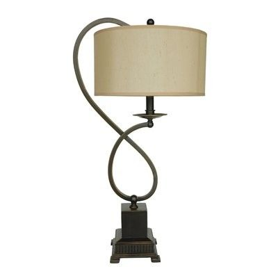 Price: $113.85 Crestview Collection CVACR160 Bronze Metal Table Lamp - Bronze Metal Table Lamp  Beige drum shade works with a variety of room styles and furniture designMetal base construction for a durable pieceBronze finished metal loop and block stand form the basePerfect table lamp to punctuate your home with its traditional lookOne year manufacturer's warranty
