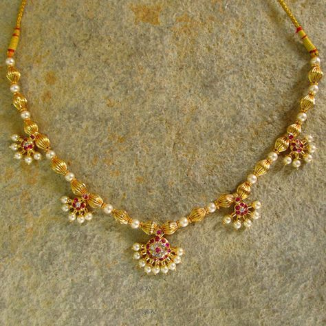 Moti Haar, traditional design in gold and pearl for a necklace, craft from India.