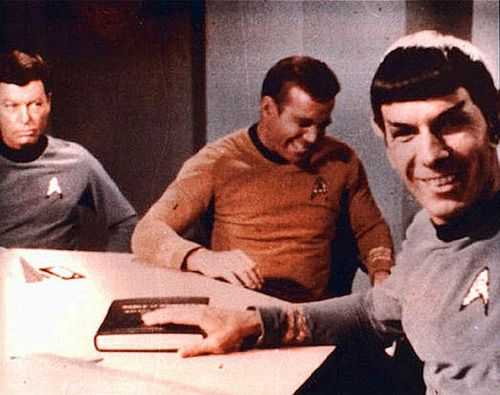 So here we have Nimoy's character saying something witty at the good Doctor's expense, Shatner is totally cracking up (even though Jim Kirk shouldn't be taking sides), and Deforest Kelly is totally PO'd that he's the butt of the joke AGAIN.