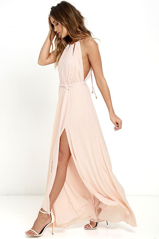Your presence will be known the second you walk by in the Gleam and Glide Blush Pink Maxi Dress! Lovely woven poly swings from a drawstring halter neckline (with gold accents), into a cutout bodice with plunging V-neck. Elasticized waist with tying sash belt tops the maxi skirt with side slit. Low V-back.