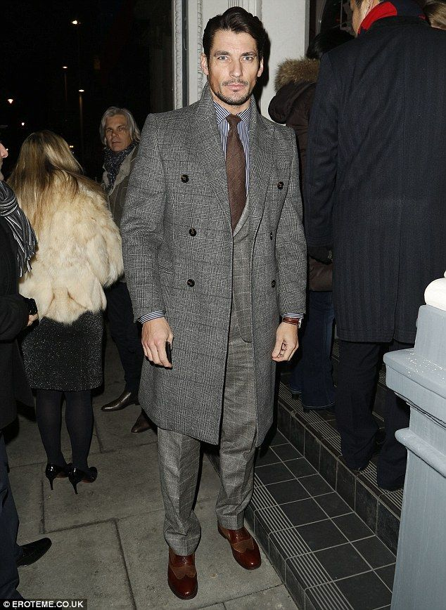 David Gandy suited and booted: David smouldered as he also left the bash in his dapper suit, tie and winter coat March 26, 2013
