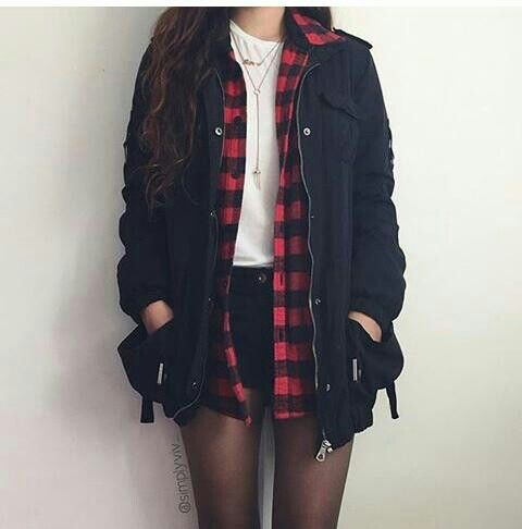 White shirt with a red plaid shirt and a black jacket and black shorts with tights