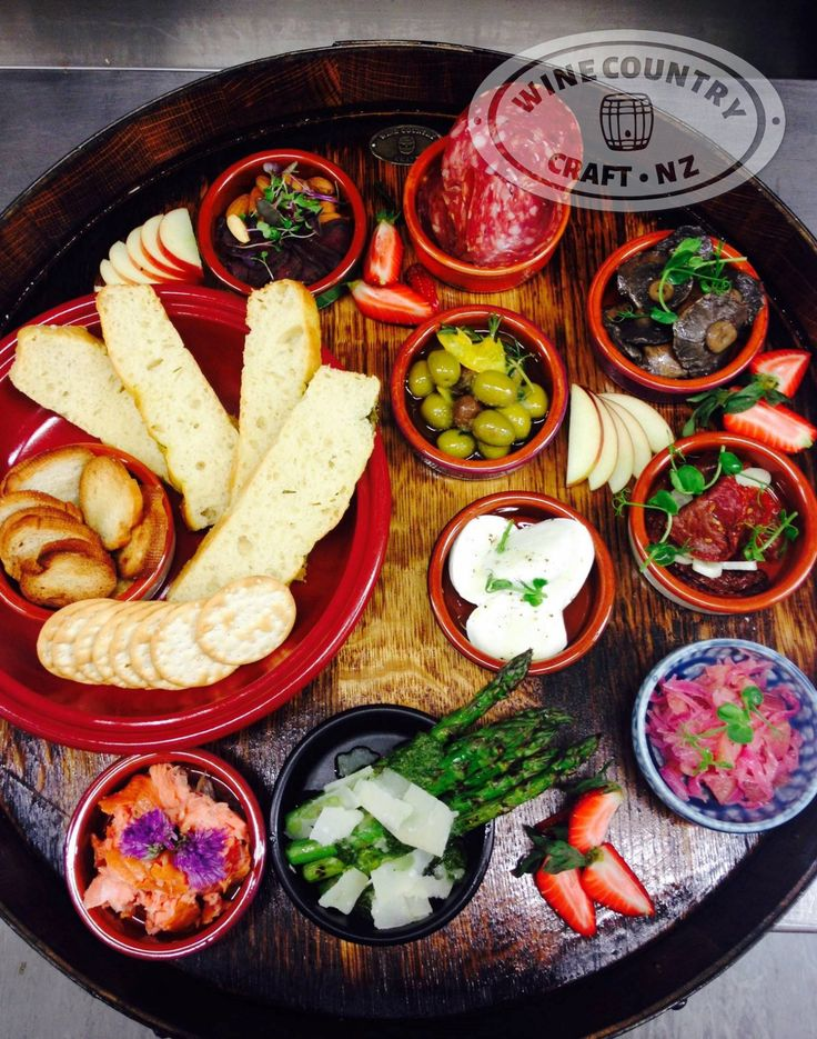 Perfect antipasto display on a recycled wine barrel platter.