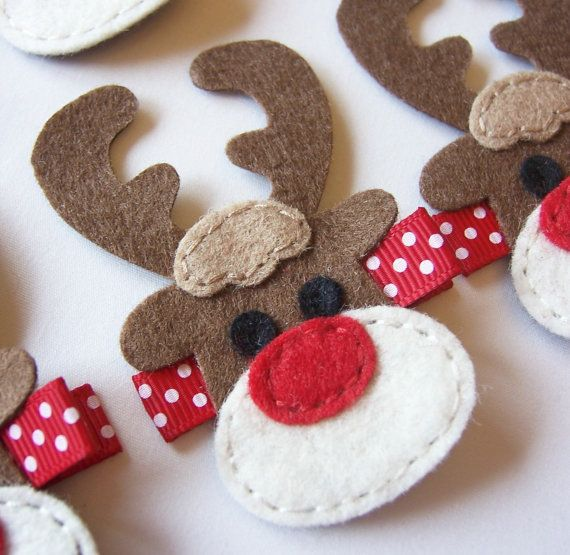 "This reindeer hair clip is so cute for the winter season!  The felt reindeer measures approximately 1 ½ wide (at its widest point) and 2 ¾ long. It is set on an alligator clip that measures 1 ¾ inches long and is partially lined with 3/8"" premium grosgrain ribbon. All of the ribbon ends have been heat treated to prevent fraying. ★ Please note I make this clip to be worn on the right side of her head. If you need it for the left side, please leave me a note when you check out. ★  I add…"