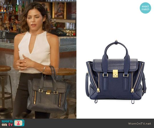 Lucy's navy bag on Supergirl.  Outfit Details: http://wornontv.net/54314/ #Supergirl