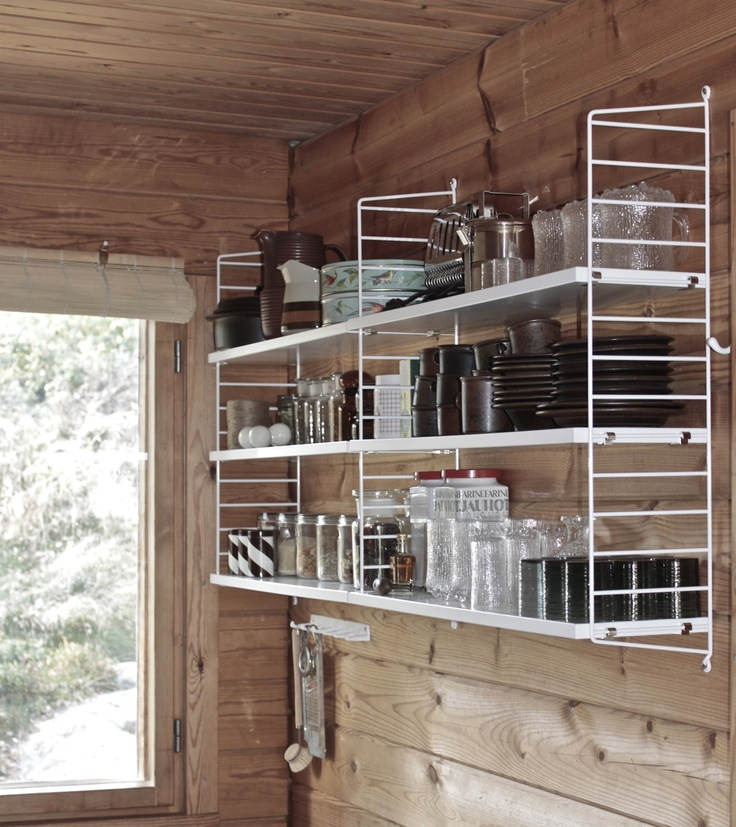 Cottage kitchen with String shelves. From the blog Time of the Aquarius.