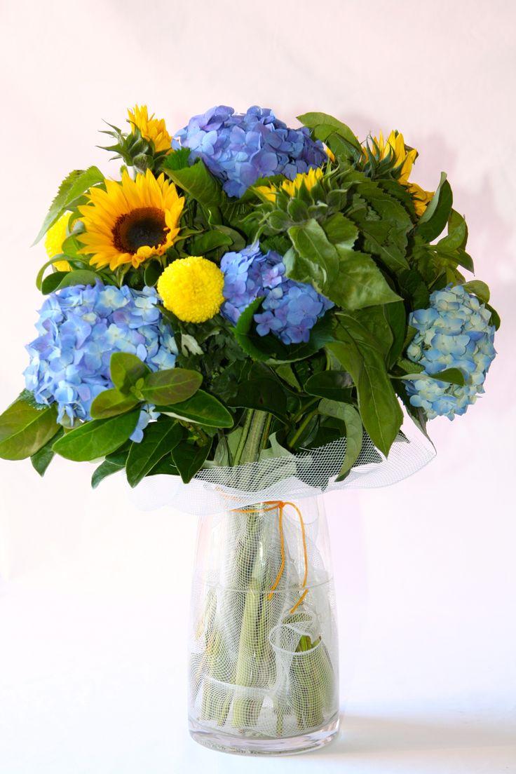 Hydrangea, Sunflower & Disbud make a stunning & colourful arrangement.