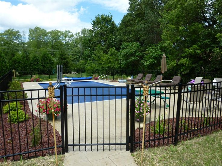 I Like That There Is A Fence Surrounding The Pool To Keep
