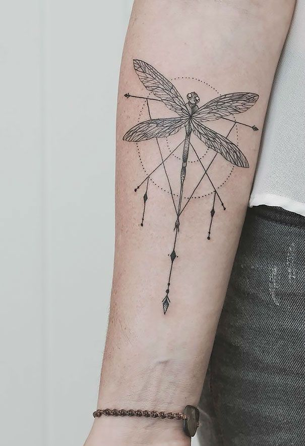 Dragonfly tattoo in geometrical style, majestic and fragile at the same time.
