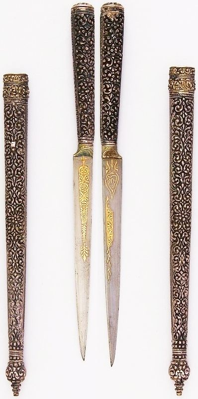 Persian dagger, 19th century, steel, silver, gold, wood, L. with sheath 13 15/16 in. (35.4 cm); L. without sheath 10 5/8 in. (27 cm); L. of blade 6 1/8 in. (15.6 cm); W. 11/16in. (1.7 cm); D. 11/16 in. (1.7 cm); Wt. 3.1 oz. (87.9 g); Wt. of sheath 5.3 oz. (150.3 g), Met Museum.