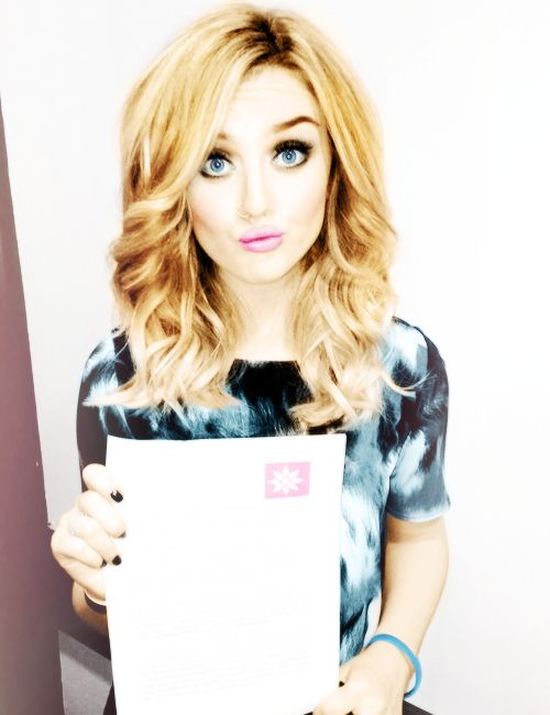 Perrie Edwards :) she looks so different