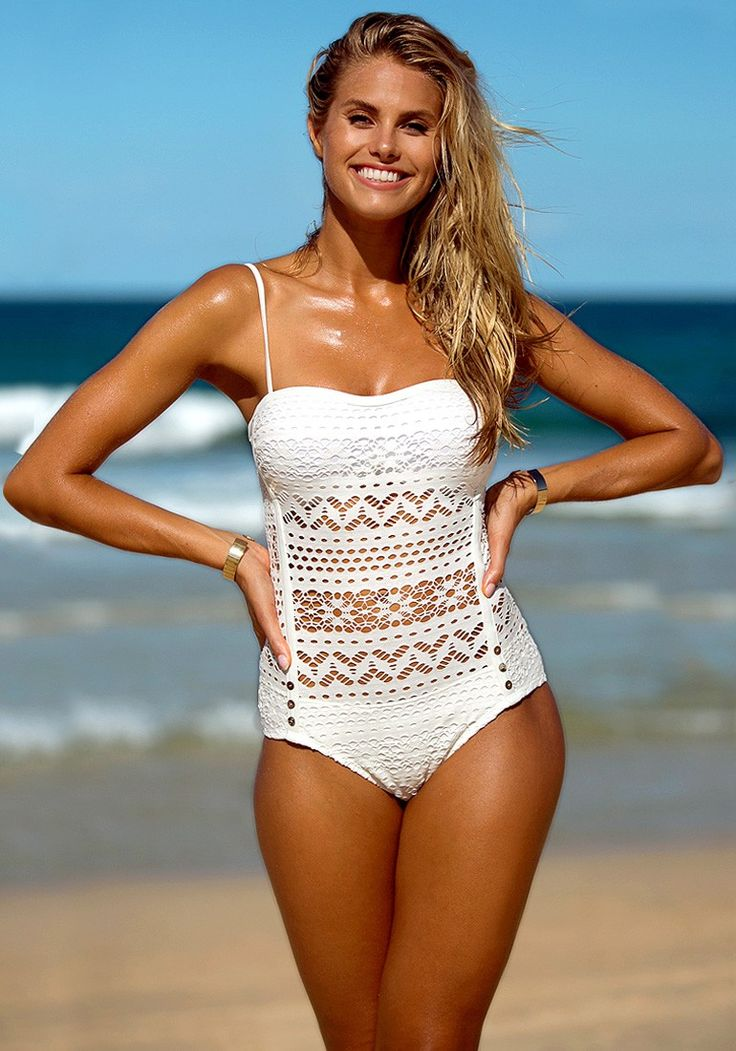 A classy way to enjoy the beach is with this white lace halter swimsuit. Love your curves with this strikingly gorgeous swimwear. (sp)